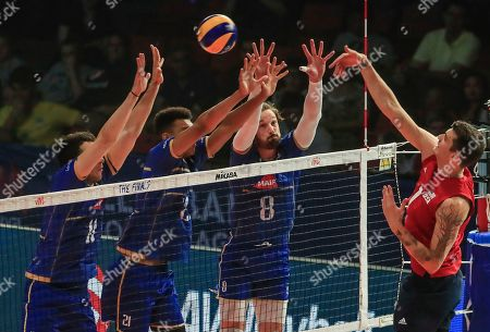 USA's Matthew Anderson (R) in action against France's Julien Lyneel (2-R) France's Barthélémy Chinenyeze (2-L) and France's Antoine Brizard (L) during the Federation Internationale de Volleyball (FIVB) Men's Nations League match between France and USA at Credit Union 1 Arena in Chicago, Illinois, USA, 10 July 2019.