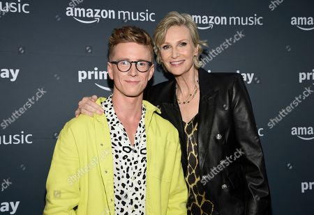 Tyler Oakley, Jane Lynch. Co-hosts Tyler Oakley, left, and Jane Lynch pose together at Amazon Music's Prime Day concert at the Hammerstein Ballroom, in New York