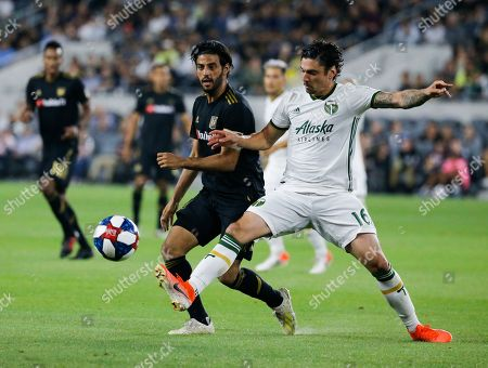 Portland Timbers defender Zarek Valentin (16) and Los Angeles FC forward Carlos Vela (10) in actions during a U.S. Open Cup quarterfinals soccer match between Los Angeles FC and Portland Timbers in Los Angeles, . The Timbers won 1-0