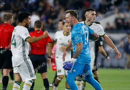 Portland Timbers goalkeeper Steve Clark (12), midfielders Andres Flores (14), and Cristhian Paredes (22) celebrate after their win against Los Angeles FC during a U.S. Open Cup quarterfinals soccer match in Los Angeles, . The Timbers won 1-0