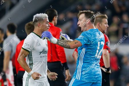 Portland Timbers goalkeeper Steve Clark (12), and Portland Timbers forward Brian Fernandez (7) celebrate after their win against Los Angeles FC during a U.S. Open Cup quarterfinals soccer match in Los Angeles, . The Timbers won 1-0