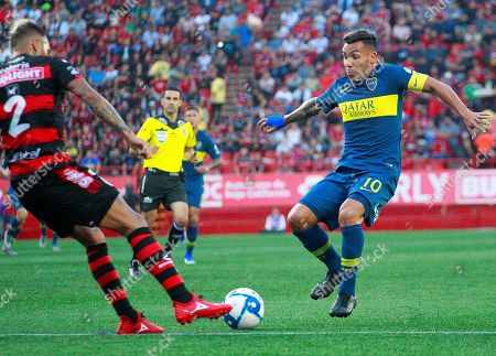 Xolos Tijuana's Julian Velazquez (L) vies for the ball against Carlos Tevez (R) of Boca Juniors during a friendly game held at the Caliente stadium in Tijuana, Mexico, 10 July 2019.
