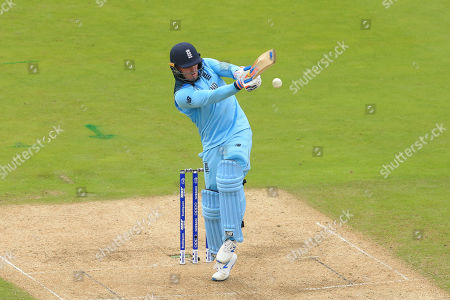 Jason Roy of England plays a shot and is caught out by Alex Carey of Australia
