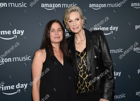 Maura Tierney, Jane Lynch. Actors Maura Tierney, left, and Jane Lynch attend Amazon Music's Prime Day concert at the Hammerstein Ballroom, in New York