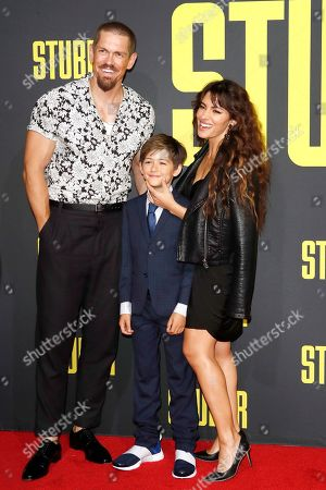 Steve Howey (L) arrives with his wife Sarah Shahi (R) and their son for the premiere of 'Stuber' at the Regal Cinemas L.A. Live in Los Angeles, California, USA, 10 July 2019. The movie opens in the US on 12 July 2019.