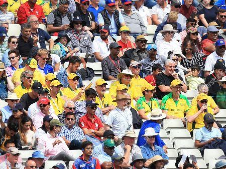 Former Australian cricketer Merv Hughes (centre) looks on from the stand