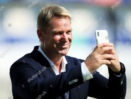 Shane Warne using his mobile phone ahead of the game