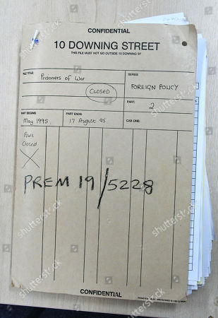 Stock Picture of Foreign Policy files from 1995 containing correspondence with Prime Minister of Japan discussing Japan's official apology to former prisoners of war and photographs of John and Norma Major during a visit to the Japanese Labour Camp Survivors of Great Britain