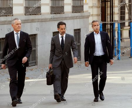 Former Spanish bank BBVA's CEO Angel Cano (R), and Ricardo Gomez Barrero, member of Garanti's Board of Administrators, arrive accompanied by lawyer Jose Bonilla (C) to tesfify as suspects before the judge Manuel Garcia-Castellon (unseen) at Audiencia Nacional Court, in Madrid, Spain, 11 July 2019. The men are being investigated as part of a investigation on the alleged spying works ordered by the bank.