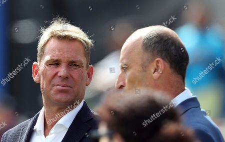 Australian cricket player Shane Warne, left, with former England cricket captain Nasser Hussein during the Cricket World Cup semi-final match between Australia and England at Edgbaston in Birmingham, England