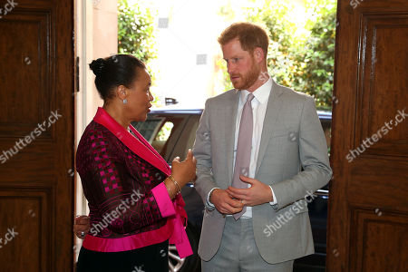 Stock Picture of Prince Harry in his role as Commonwealth Youth Ambassador with Baroness Patricia Scotland, Commonwealth Secretary-General during a Commonwealth Youth roundtable at Marlborough House