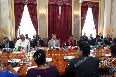 Prince Harry in his role as Commonwealth Youth Ambassador with Baroness Patricia Scotland, Commonwealth Secretary-General (R) during a Commonwealth Youth roundtable at Marlborough House