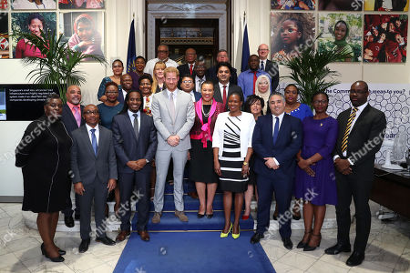 Prince Harry in his role as Commonwealth Youth Ambassador with Baroness Patricia Scotland, Commonwealth Secretary-General and ministers responsible for youth engagement pose for a photograph after a Commonwealth Youth roundtable at Marlborough House