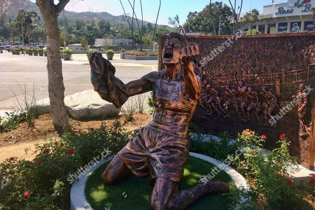 Stock Picture of A statue capturing Brandi Chastain's iconic reaction to scoring the U.S. team's winning goal in the 1999 Women's World Cup, is shown after being unveiled outside the Rose Bowl in Pasadena, Calif., . The 20th anniversary of the historic win coincided with celebrations in New York for this year's World Cup soccer championship team