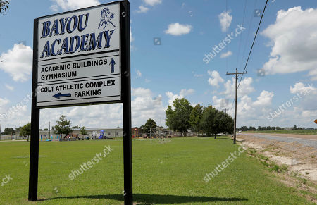 Grassy fields border Bayou Academy in Cleveland, Miss., one of two private schools that have a predominately white student body