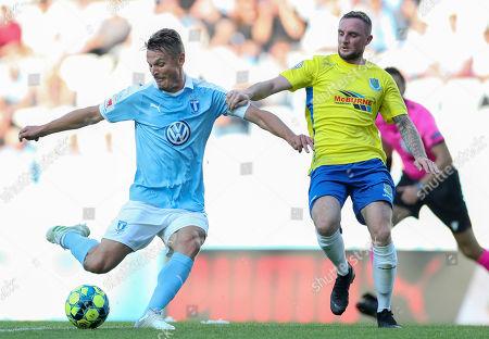 Malmo´s Markus Rosenberg (L) against Ballymena´s Kofi Balmer during the UEFA Europa League qualifying match between Malmo FF and Ballymena United FC in Malmo, Sweden, 11 July 2019.