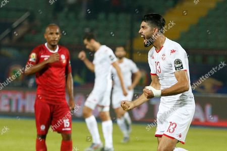 Tunisia's Ferjani Sassi celebrates after scoring during the African Cup of Nations quarterfinal soccer match between Madagascar and Tunisia in Al Salam stadium in Cairo, Egypt