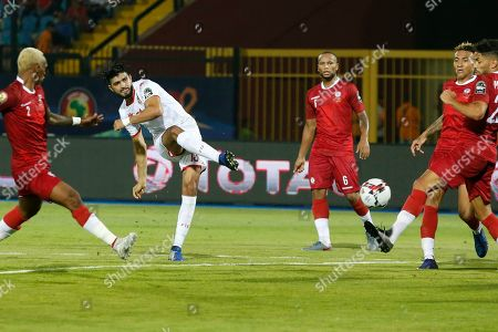 Tunisia's Ferjani Sassi scores his team's first goal during the African Cup of Nations quarterfinal soccer match between Madagascar and Tunisia in Al Salam stadium in Cairo, Egypt