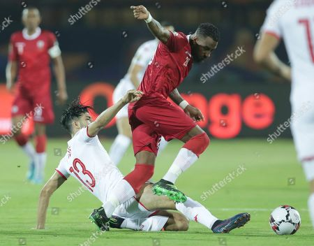 Tunisia's Ferjani Sassi tackles Madagascar's Romain Metanire during the African Cup of Nations quarterfinal soccer match between Madagascar and Tunisia in Al Salam stadium in Cairo, Egypt