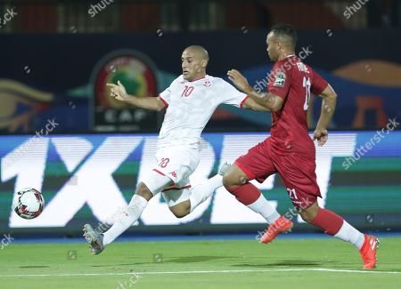 Tunisia's Wahbi Khazri, left, and Madagascar's Thomas Fontaine run for the ball during the African Cup of Nations quarterfinal soccer match between Madagascar and Tunisia in Al Salam stadium in Cairo, Egypt