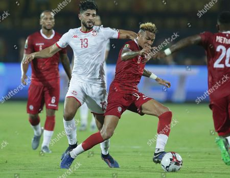 Madagascar's Anicet Andrianantenaina in action in front of Tunisia's Ferjani Sassi during the African Cup of Nations quarterfinal soccer match between Madagascar and Tunisia in Al Salam stadium in Cairo, Egypt