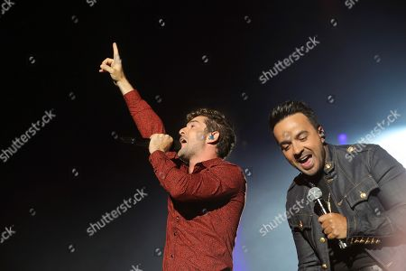 Stock Picture of David Bisbal (L) and Puerto Rican singer Luis Fonsi (R) perform on stage during the concert of 'La Voz' (The Voice) held in Madrid, Spain, 11 July 2019.