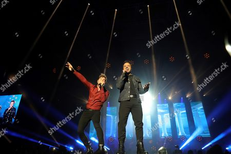 Stock Photo of David Bisbal (L) and Puerto Rican singer Luis Fonsi (R) perform on stage during the concert of 'La Voz' (The Voice) held in Madrid, Spain, 11 July 2019.
