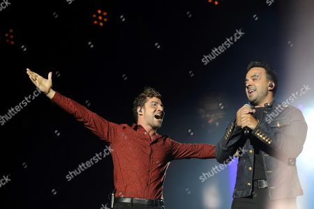 David Bisbal (L) and Puerto Rican singer Luis Fonsi (R) perform on stage during the concert of 'La Voz' (The Voice) held in Madrid, Spain, 11 July 2019.