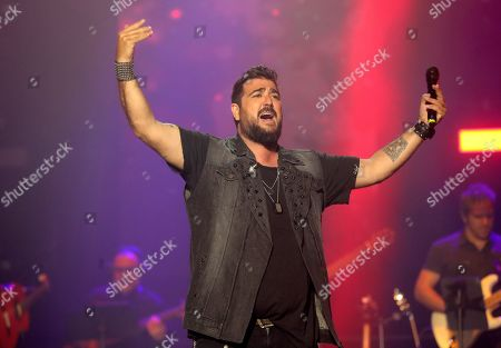 Antonio Orozco performs on stage during the concert 'La Voz' (The Voice) held in Madrid, Spain, 11 July 2019.