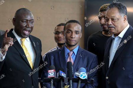 Shaquille Dukes, center, and Rev. Jesse Jackson, right, listen as his attorney Ben Crump, left, speaks during a news conference in Chicago, . Dukes stated that he was wrongfully arrested last month outside FHN Memorial Hospital in Freeport, IL., while still attached to an IV. An independent investigator, Wednesday, found no evidence of police misconduct or racial bias in the arrest of Dukes, a black patient who was accused by a white security officer of stealing equipment when he stepped outside a northern Illinois hospital last month while still attached to an IV stand