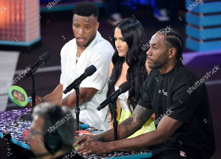 Saquon Barkley, Nikki Bella, Kawhi Leonard. NFL player, Saquon Barkley, of the New York Giants, from left, Nikki Bella, and Kawhi Leonard judge the Pillow Fight Fight Night challenge at the Kids' Choice Sports Awards, at the Barker Hangar in Santa Monica, Calif