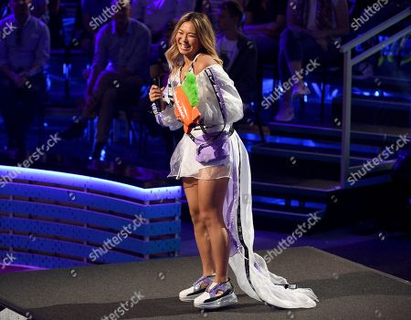 Chloe Kim accepts the favorite action sports star award at the Kids' Choice Sports Awards, at the Barker Hangar in Santa Monica, Calif