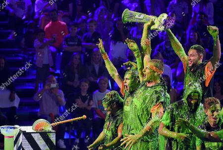 Rob Gronkowski, Shaun White, Ben Simmons, Laurie Hernandez, David Dorik. The Orange Crush team reacts after winning the super slime showdown at the Kids' Choice Sports Awards, at the Barker Hangar in Santa Monica, Calif