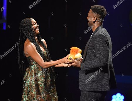 Gabrielle Union, Dwayne Wade. Gabrielle Union, left, presents the legend award to husband Dwayne Wade at the Kids' Choice Sports Awards, at the Barker Hangar in Santa Monica, Calif