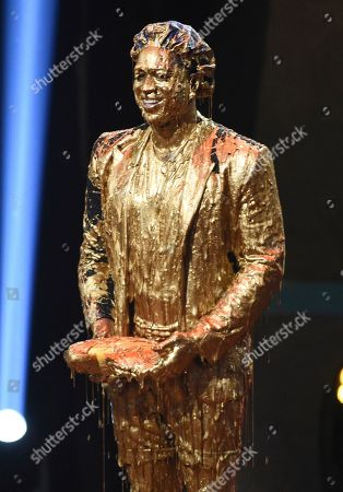 Dwayne Wade, winner of the legend award, appears on stage after getting slimed at the Kids' Choice Sports Awards, at the Barker Hangar in Santa Monica, Calif
