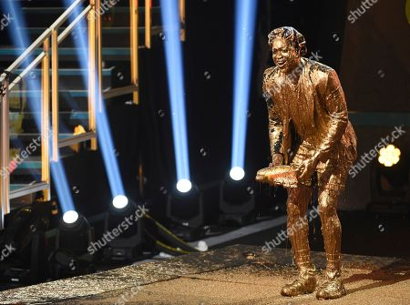 Dwayne Wade, winner of the legend award, reacts after getting slimed at the Kids' Choice Sports Awards, at the Barker Hangar in Santa Monica, Calif