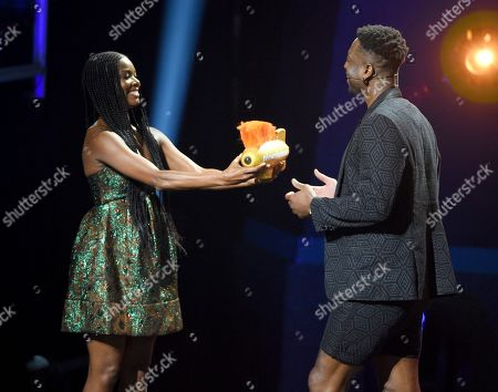 Stock Photo of Gabrielle Union, Dwayne Wade. Gabrielle Union, left, presents the legend award to husband Dwayne Wade at the Kids' Choice Sports Awards, at the Barker Hangar in Santa Monica, Calif