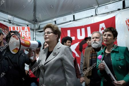 Spanish writer Pilar del Rio (R) and Brazilian former president Dilma Rousseff (L) meet with Brazilian former president Luiz Inacio Lula da Silva's supporters after visiting him in jail at the headquarter of the Parana's state Federal Police in Curitiba, Brazil, 11 July 2019. Lula has been in prison since April of last year serving a sentence of 8 years and 10 months in prison for corruption and money laundering.