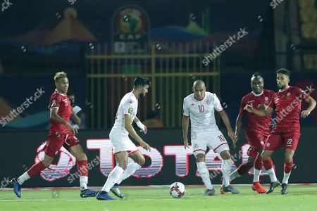 Tunisia's Ferjani Sassi, second left, scores his side's opening goal during the African Cup of Nations quarterfinal soccer match between Madagascar and Tunisia in Al Salam stadium in Cairo, Egypt