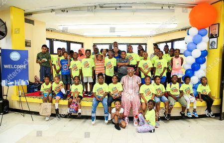 Aisha Hinds Brooklyn native poses with the children at the unveil event
