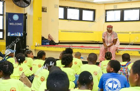 Aisha Hinds Brooklyn native talks to the children at the unveil event