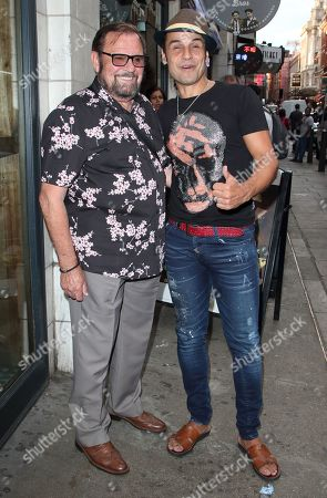 Stock Photo of Chico Slimani and a guest attend the Paul Strank Charitable Trust Summer Party at Opium night club, Rupert Street in London.