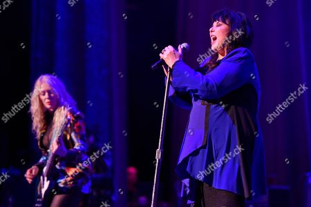 """Nancy Wilson, Ann Wilson. Nancy Wilson, left, and Ann Wilson of Heart perform during the """"Love Alive Tour"""" at the Hollywood Casino Amphitheatre, in Chicago"""