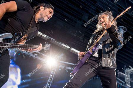 Kirk Hammett (R) and bassist Roberto Trujillo (L) of US rock band Metallica perform on stage during a concert at Parken Stadium in Copenhagen, Denmark, 11 July 2019.