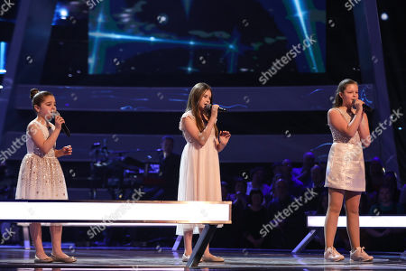 Stock Image of The Battles: Team Jessie: Keira, Jazzy B and Connie perform.