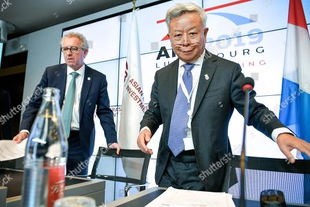 AIIB President Jin Liqun (R) and Luxembourg's Finance Minister Pierre Gramegna (L) arrive for a joint press conference during the 4th annual meeting of the Asian Infrastructure Investment Bank (AIIB) at the European Convention Centre in Luxembourg, 12 July 2019. The theme of the 2019 annual meeting is cooperation and connectivity in recognition of the economic and social benefits to be realized through better connectivity within and between countries and regions, including Europe and Asia. The dialogue will focus on how cooperation and strategic investments in sustainable infrastructure can contribute to deeper integration and stronger economic growth via enhanced and strengthened connectivity.