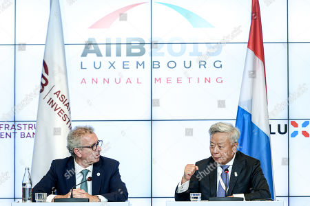 AIIB President Jin Liqun (R) and Luxembourg's Finance Minister Pierre Gramegna (L) attend a joint press conference of the 4th annual meeting of the Asian Infrastructure Investment Bank (AIIB) at the European Convention Centre in Luxembourg, 12 July 2019. The theme of the 2019 annual meeting is cooperation and connectivity in recognition of the economic and social benefits to be realized through better connectivity within and between countries and regions, including Europe and Asia. The dialogue will focus on how cooperation and strategic investments in sustainable infrastructure can contribute to deeper integration and stronger economic growth via enhanced and strengthened connectivity.