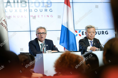 Stock Photo of AIIB President Jin Liqun (R) and Luxembourg's Finance Minister Pierre Gramegna (L) attend a joint press conference of the 4th annual meeting of the Asian Infrastructure Investment Bank (AIIB) at the European Convention Centre in Luxembourg, 12 July 2019. The theme of the 2019 annual meeting is cooperation and connectivity in recognition of the economic and social benefits to be realized through better connectivity within and between countries and regions, including Europe and Asia. The dialogue will focus on how cooperation and strategic investments in sustainable infrastructure can contribute to deeper integration and stronger economic growth via enhanced and strengthened connectivity.