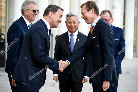 (L-R) Luxembourg's Finance Minister Pierre Gramegna, Luxembourg's Prime Minister Xavier Bettel and AIIB President Jin Liqun welcome the Grand Duke Henri of Luxembourg prior to the 4th annual meeting of the Asian Infrastructure Investment Bank (AIIB) at the European Convention Centre in Luxembourg, 12 July 2019. The theme of the 2019 annual meeting is cooperation and connectivity in recognition of the economic and social benefits to be realized through better connectivity within and between countries and regions, including Europe and Asia. The dialogue will focus on how cooperation and strategic investments in sustainable infrastructure can contribute to deeper integration and stronger economic growth via enhanced and strengthened connectivity.