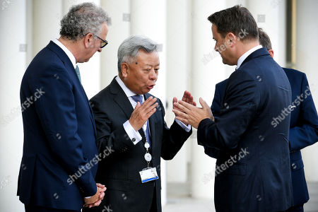 (L-R) Luxembourg's Finance Minister Pierre Gramegna and AIIB President Jin Liqun welcome Luxembourg's Prime Minister Xavier Bettel prior to the 4th annual meeting of the Asian Infrastructure Investment Bank (AIIB) at the European Convention Centre in Luxembourg, 12 July 2019. The theme of the 2019 annual meeting is cooperation and connectivity in recognition of the economic and social benefits to be realized through better connectivity within and between countries and regions, including Europe and Asia. The dialogue will focus on how cooperation and strategic investments in sustainable infrastructure can contribute to deeper integration and stronger economic growth via enhanced and strengthened connectivity.